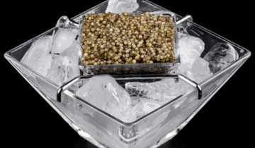 How is caviar prepared and served for consumption?